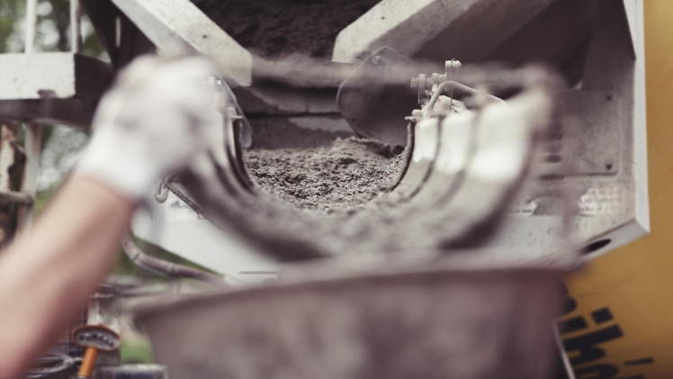 Cement Flowing in a Mixer,Close-Up of a Concrete Mixer